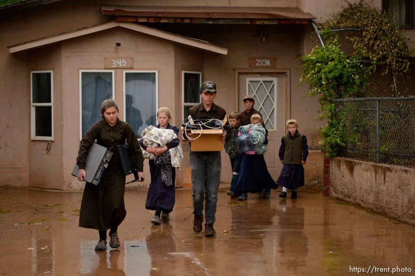 Trent Nelson | The Salt Lake Tribune FLDS children carry belongings as they are evicted from their Colorado City, AZ, home by the UEP Trust after refusing to sign an occupancy agreement, Wednesday May 10, 2017.