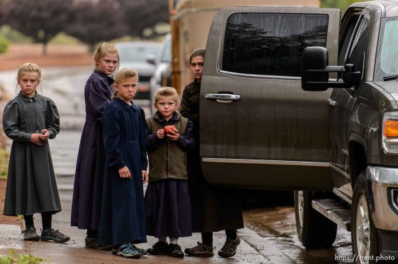 Trent Nelson | The Salt Lake Tribune FLDS children look on after being evicted from their Colorado City, AZ, home by the UEP Trust after refusing to sign an occupancy agreement, Wednesday May 10, 2017.