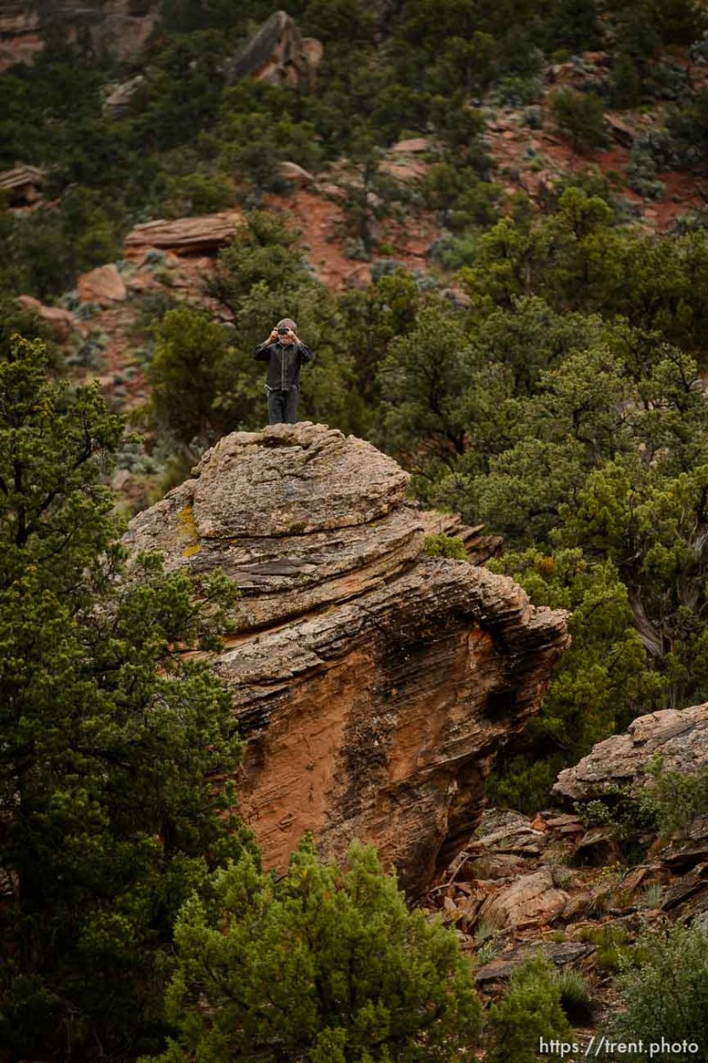 Trent Nelson | The Salt Lake Tribune FLDS boy photographs from the top of a rock as the UEP changes the locks on the home at 560 E Johnson Ave, Colorado City, AZ, Wednesday May 10, 2017.
