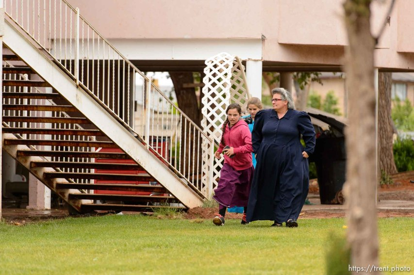 Trent Nelson | The Salt Lake Tribune UEP eviction of property at 555 N Lauritzen Ave, Colorado City, AZ, Wednesday May 10, 2017. Shannon Darger and two FLDS children walk away after confrontation.