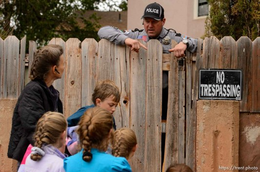 Trent Nelson | The Salt Lake Tribune Colorado City Town Marshal Sam Johnson tells an FLDS woman who had been evicted from her Colorado City, AZ, home, that she will be allowed to retrieve her belongings from the yard, Wednesday May 10, 2017.