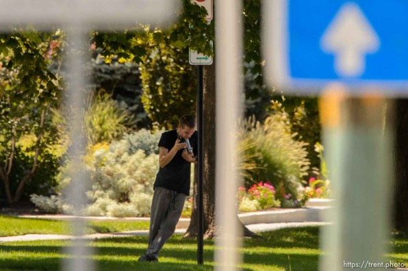 (Trent Nelson | The Salt Lake Tribune) A young man holds a gun to his head during a standoff with police in Salt Lake City, Friday September 1, 2017.