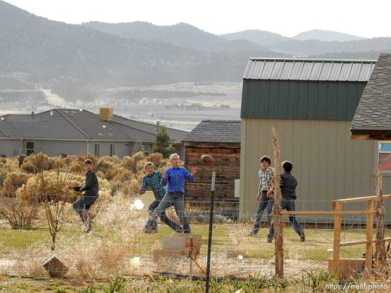 (Trent Nelson | The Salt Lake Tribune) A group of boys play backyard football at a Cedar City home where members of the FLDS are purported to live, Wednesday November 8, 2017.