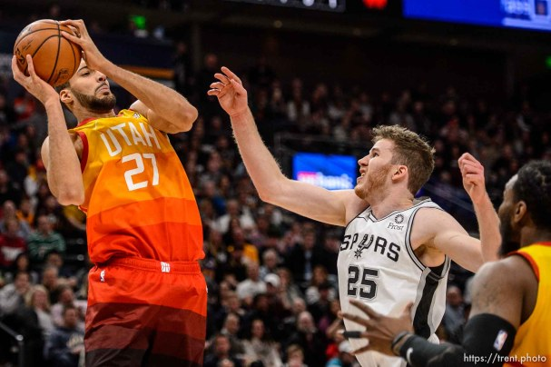 (Trent Nelson | The Salt Lake Tribune) Utah Jazz center Rudy Gobert (27) rebounds ahead of San Antonio Spurs center Jakob Poeltl (25) as the Utah Jazz host the San Antonio Spurs, NBA basketball in Salt Lake City on Saturday Feb. 9, 2019.