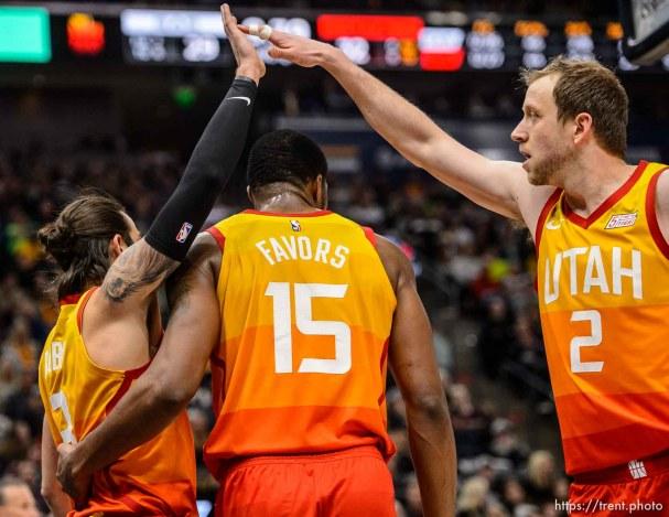 (Trent Nelson | The Salt Lake Tribune) Utah Jazz guard Ricky Rubio (3) and Utah Jazz forward Joe Ingles (2) high-five over Utah Jazz forward Derrick Favors (15) as the Utah Jazz host the San Antonio Spurs, NBA basketball in Salt Lake City on Saturday Feb. 9, 2019.