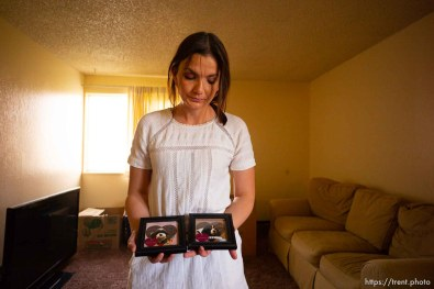 (Trent Nelson   The Salt Lake Tribune) Michelle Densley gets emotional showing photos of two dogs she had to give up when her living conditions changed, at her apartment in Salt Lake County on Monday April 8, 2019.