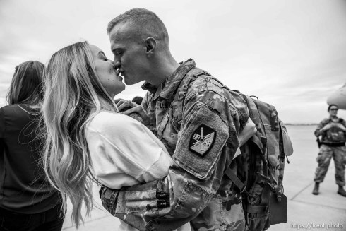 """(Trent Nelson   The Salt Lake Tribune) Specialist Porter Black is welcomed home by his wife Taylor as almost 100 Soldiers from Utah Army National Guard's Echo Battery, 1st Battalion, 145th Field Artillery, """"Big Red"""" return after a 10-month Middle East deployment, on Tuesday April 9, 2019 at Wright Air Base in Salt Lake City."""
