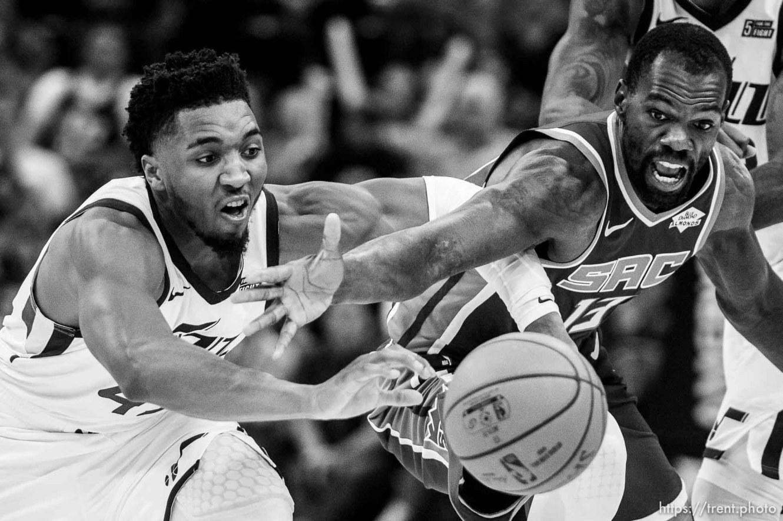 (Trent Nelson | The Salt Lake Tribune) Utah Jazz guard Donovan Mitchell (45) and Sacramento Kings center Dewayne Dedmon (13) reach for the ball as the Utah Jazz hosts the Sacramento Kings, NBA basketball in Salt Lake City on Monday Oct. 14, 2019.