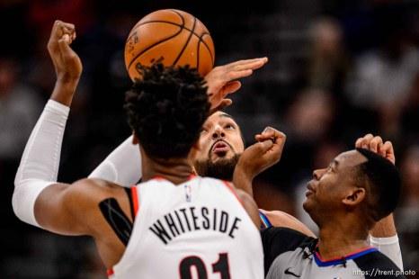 (Trent Nelson | The Salt Lake Tribune) Utah Jazz center Rudy Gobert (27) and Portland Trail Blazers center Hassan Whiteside (21) as the Utah Jazz host the Portland Trail Blazers, NBA basketball in Salt Lake City on Thursday, Dec. 26, 2019.