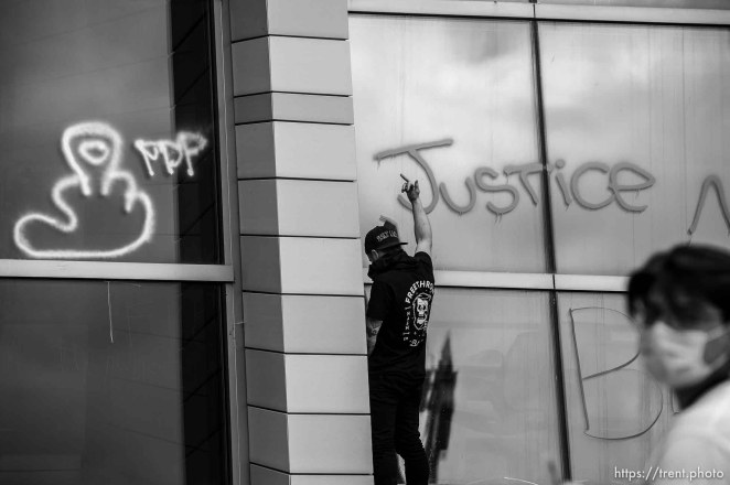 (Trent Nelson | The Salt Lake Tribune) Protestors rally against police brutality in Salt Lake City on Saturday, May 30, 2020. Salt Lake Police Department headquarters.
