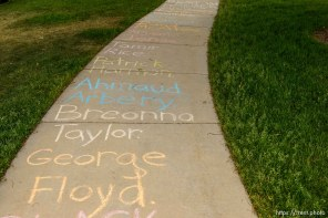 (Trent Nelson | The Salt Lake Tribune) Names written on the sidewalk as protesters rally against police brutality rally at the State Capitol in Salt Lake City on Friday, June 5, 2020.