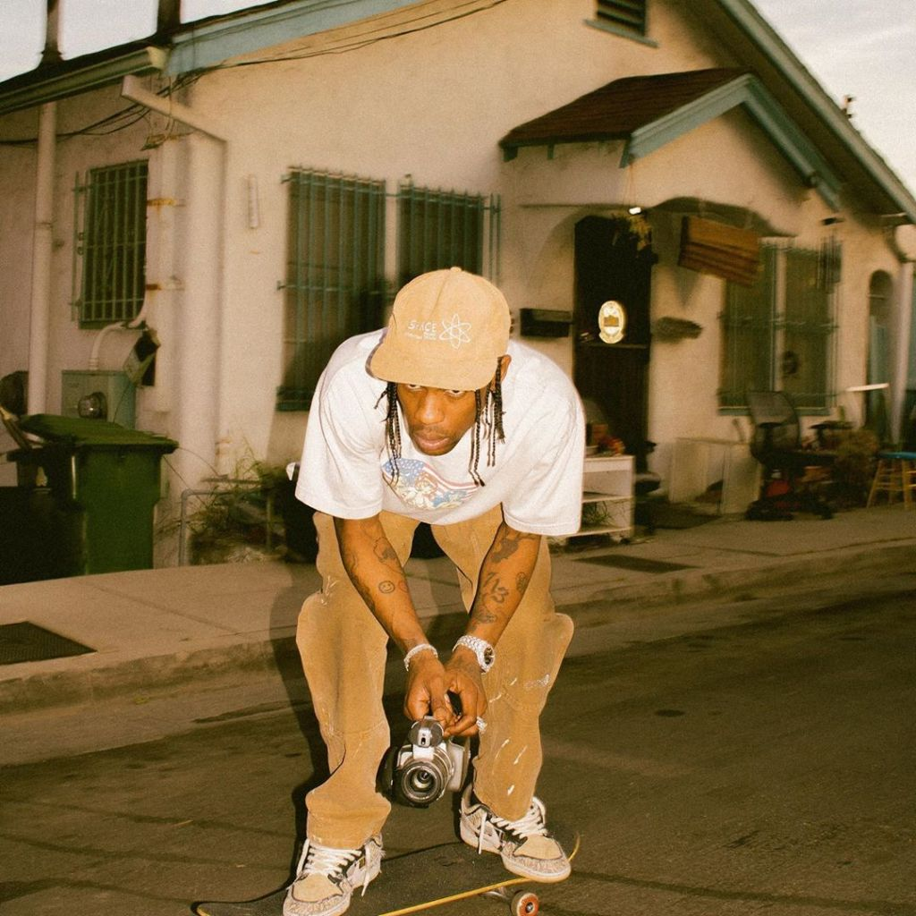 Travis Scott on skateboard wearing the Nike SB Dunk Low at Los Angeles
