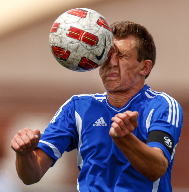 Dixie High School's Quinton Gray heads the ball in action vs. Wasatch.