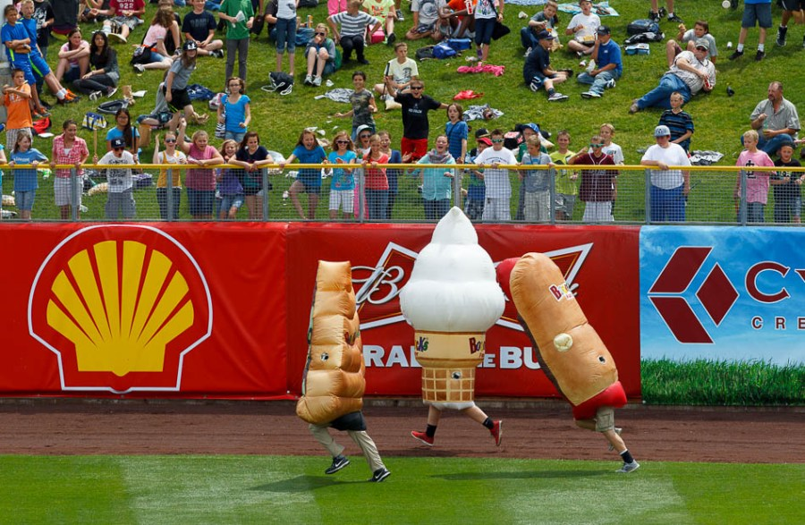 foot race between a slice of pizza, ice cream cone, and a hot dog