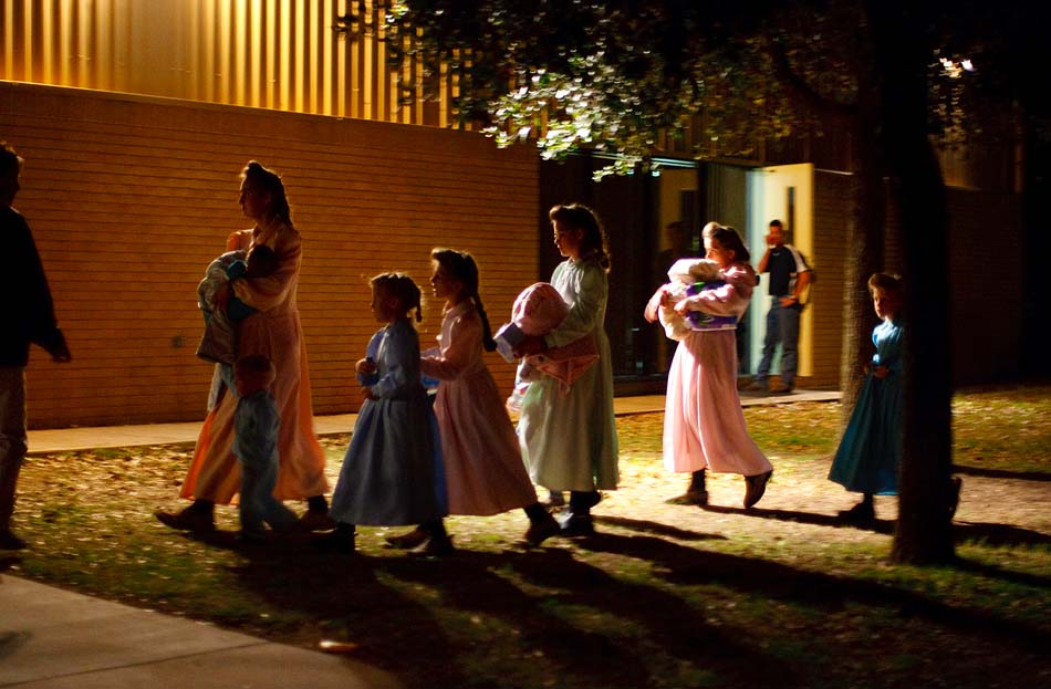Eldorado, Texas - In April 2008, Child Protective Services (CPS) raided a polygamous sect's Texas ranch and removed 416 children after receiving phone calls, now believed to be a hoax, from someone claiming to be an abused sixteen-year-old girl. This raid on the FLDS Church's YFZ (Yearning for Zion) Ranch became the largest child custody case in United States history. Here, on the first night of removals, young FLDS women and children are taken into shelter at the First Baptist Church in Eldorado, Texas.