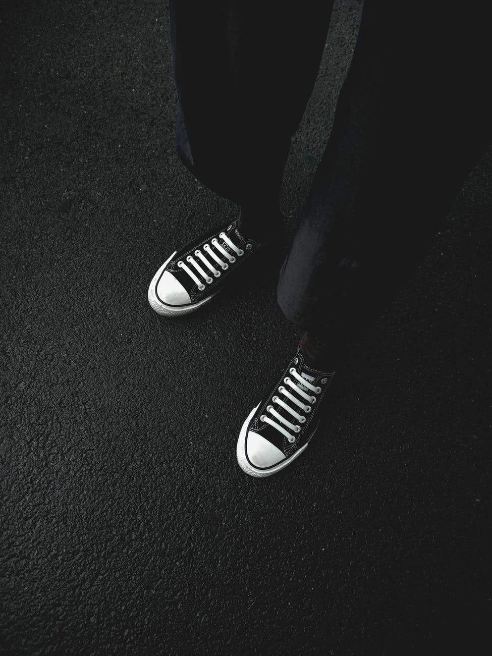 crop person in stylish sneakers