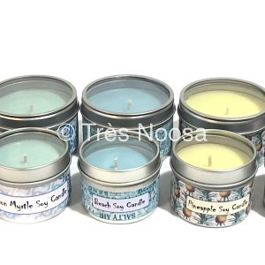 Assorted scented and coloured soy candles in small tin container