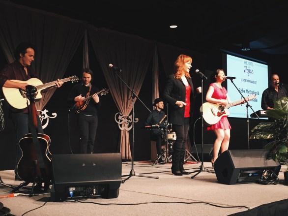 Reba McEntire performs with Caroline Kole.