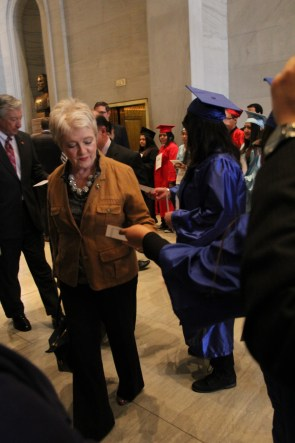 Senator Janice Bowling is handed information on the bill as she enters Senate Chambers