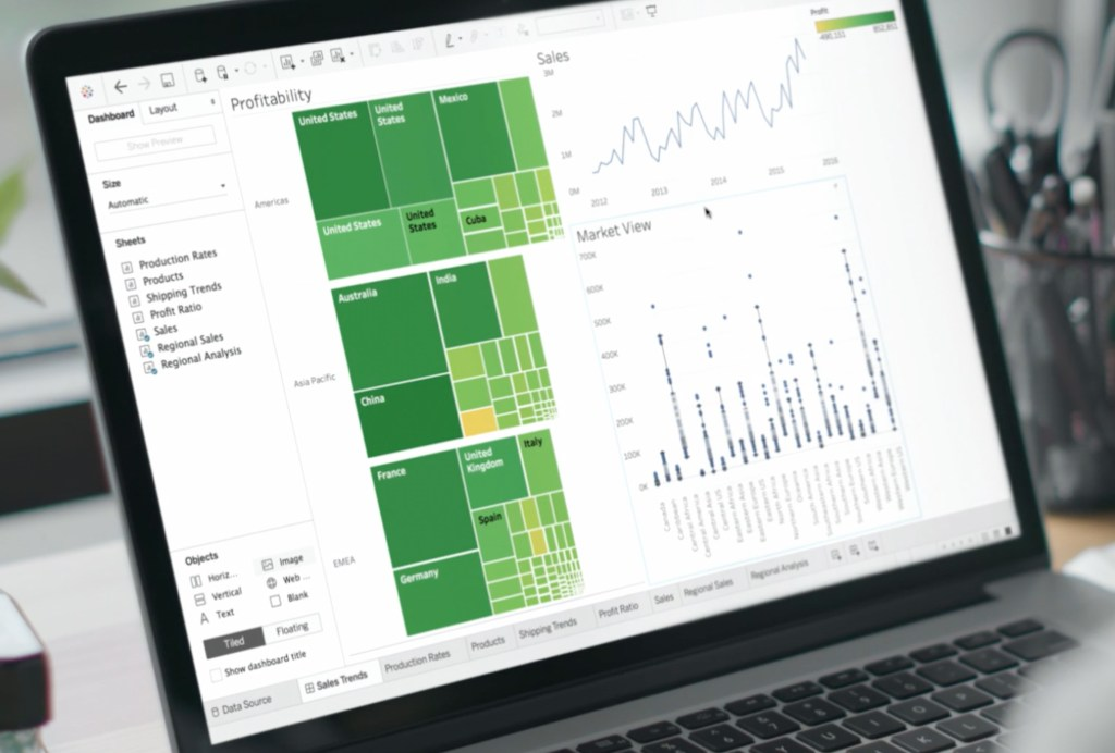 Open computer showing Tableau tool data visualizations