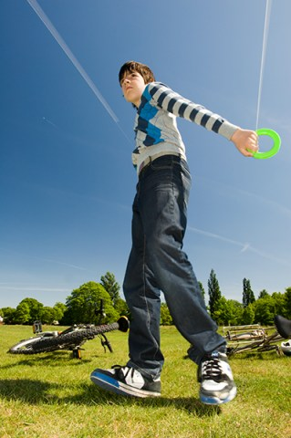 stock photograph of boy flying kite