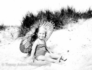 mum on beach with parasol copy