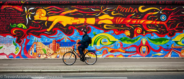 Photograph of a painting on the Berlin Wall. photography photographer