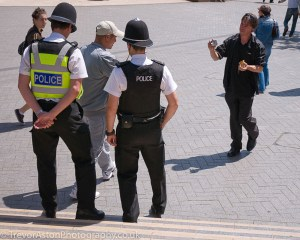 Take Better Photos in Teddington - tourists asking a policeman to take their picture