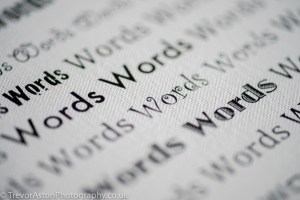 """photograph of """"word"""" printed many times"""