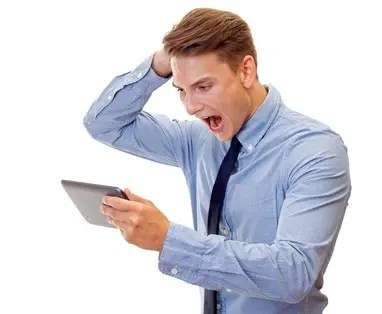 Businessman shouting at his tablet due to poor website design