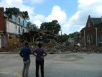 Kilby Hotel co-owner Burnie McElrath surveys the damage with a TV reporter
