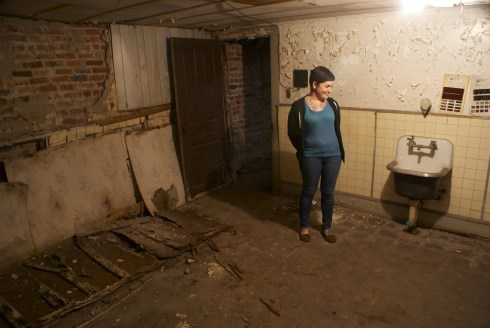 Neely in the embalming room in the basement.