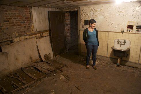 Neely in the embalming room in the basement.