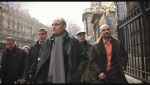 Phillipe Val, then editor in chief of Charlie Hebdo, is seen walking with other members of the newspaper staff to and from the courtroom.