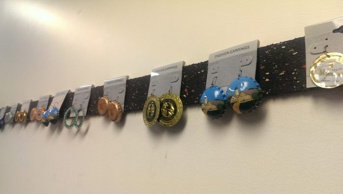 Earrings made from beer bottlecaps hung from a wall in one classroom. (Sayaka Matsuoka)