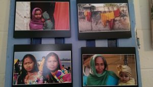 Pictures of women and children photographed by Holliday during her trip to Nepal decorated the walls of 512 Collective. (Sayaka Matsuoka)