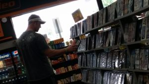 Bryan King searches the Family DVDs. (Chris Nafekh)