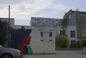 A mural by the same artist remains on another portion of the mill.