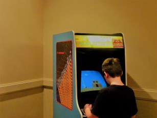 This kid sure seemed interested in playing the Super Mario Bros. arcade machine.