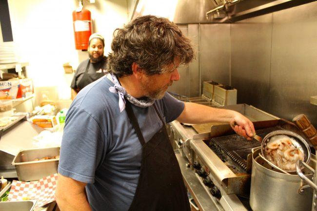 Jody-Morphis-cooking-a-shrimp-boil-at-blue-denim-restaurant