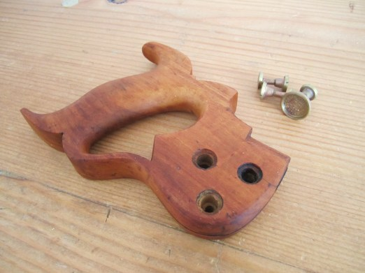 sanded and oiled saw handle