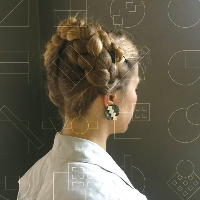 Geometric graphics on a woman who is wearing the leather accessory mimiphis