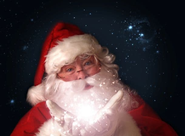Santa Holding Magical Christmas Lights In Hands