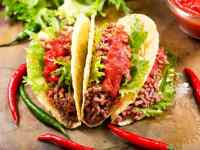 Mexican Tacos With Meat And Salsa On A Board
