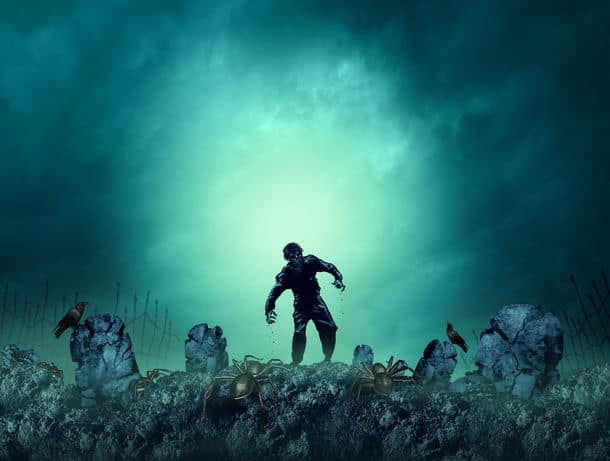 Zombie Grave Halloween Background As A Creepy Walking Monster In A Blank Area For Text As A Spooky Dead Scary Ghost As An Autumn Holiday Greeting With