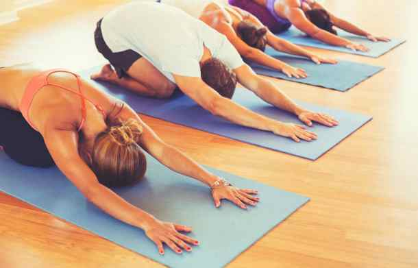 stock image of people taking a yoga class