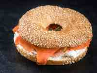 sesame seed bagel with cream cheese and smoked salmon