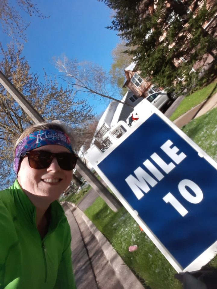 Lisa at mile 10 marker