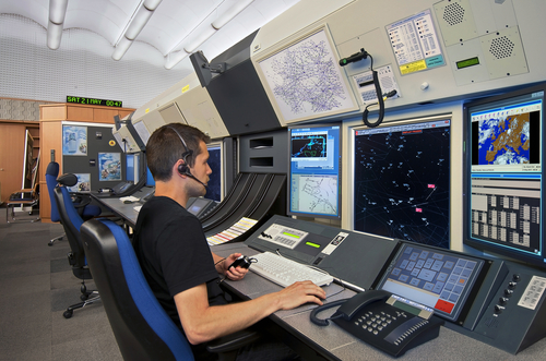 Air traffic controller sat working at a computer