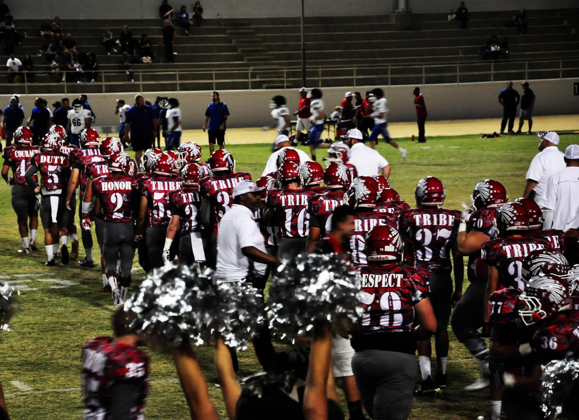 Football+Players+line+up+to+shake+hands+with+other+team+to+show+respect.Photo+By+Madison+Velez